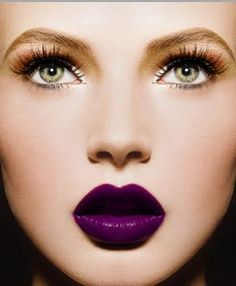 Bold purple lip.