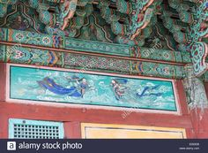 Colorful art of paintings on wood at a korean buddhist temple with flying figures Stock Photo