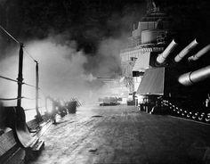 Battleship USS California during night gunnery exercises, 1933.