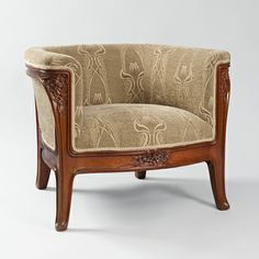 "Louis Majorelle (1859-1926) - Lounge Chair. Carved Beech Wood. Circa 1900. 24-1/2"" (62.2cm)."
