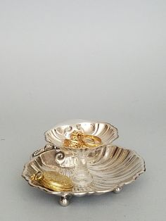 Check out Silver Plate Tiered Stand Ring Dish Silver Plate Shells Jewelry Dish Tray Brides Ring Stand on decadesemporium
