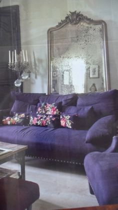 What an awesome purple couch and I love the old mirror and the candlelabra. My Living Room, Home And Living, Lila Sofa, Purple Furniture, Couch Furniture, Purple Couch, Purple Rooms, Romantic Room, Deco Boheme