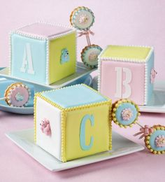 Baby block and rattle cookies by Julia M. Usher. Photo by Steve Adams. Outtake from Julia M. Usher's Ultimate Cookies (Gibbs Smith Publisher)