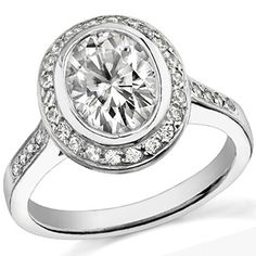 This Tiffany diamond and platinum engagement  ring has an art deco feel. For different setting ideas see our guide at: www.custommade.com/buyer-guides/engagement-rings/