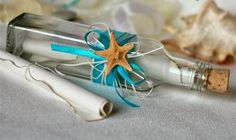 put voucher in glass bottle decorated with seastar