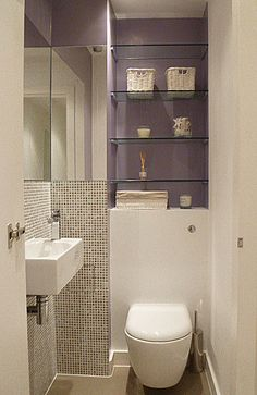 Design by Global Inspirations Design: conversion of a flat near Sloane Sqare, London; maximizing space in a tiny cloakroom  www.globalinspirationsdesign.com