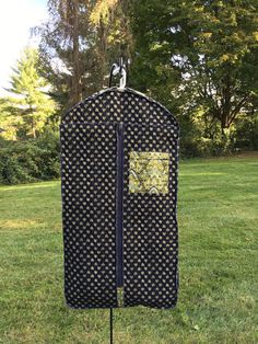 """Quilted Garment Bag 2 - 8""""x8""""outer pockets w/ zippers 1 - 8""""x8""""inner pocket w/ zipper 2 - 20""""x8"""" inner pockets w/ zippers Opening is with a durable 30"""" sport zipper 22"""" wide, 3 1/2"""" deep, 41 3/4"""" long Includes hanger tab and a securing back strap to enable ease of carrying in the folded position Photos of quilted garment bag are shown with 5 dresses inside inner garment bags Machine washable in cold water  Can be sold as a set with 2 or more inner bags or individually..."""