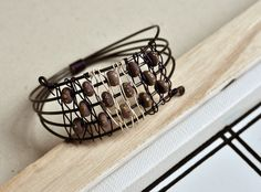 Analog, from Rustic Wrappings by Kerry Bogert, Bead by Mika Collins