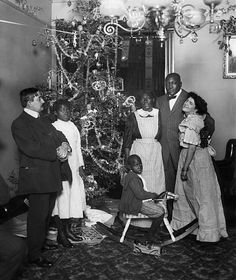 Jack Johnson, boxer, USA, with wife Etta Duryea and Johnson's mother in his new apartment, Christmas photo by Burke & Atwell Bourbon, Jack Johnson Boxer, James Whale, Luis Xiv, Alice, Journey's End, 1975, Framed Prints, Canvas Prints
