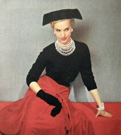 Venetian red velvet suit, scarf, and hat. Suit by Adele Simpson. Jewels by Van Cleef & Arpels. Guava red wool suit, challis blous...
