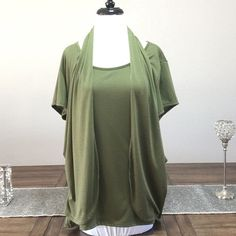 Green Top Free top with faux vest.  Fun to wear and easy to combine with.  In good condition no stains or rips tag says 3X but fits a 2X.  Very pretty you'll love. It. Tops