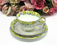 Crown Staffordshire cup, saucer, 2 plates with blue and yellow flowers and grey lace pattern, F15034, fine bone china, England, 1930s - 1956 by CardCurios on Etsy