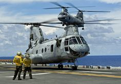 A helicopter approaches the flight deck. by Official U.S. Navy Imagery, via Flickr