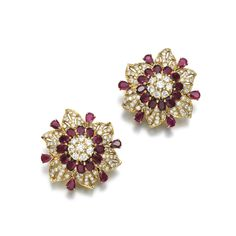 Pair of ruby and diamond ear clips, Bulgari Each of stylised flower design set with oval and pear-shaped rubies and brilliant-cut diamonds, signed Bulgari, pouches stamped Bulgari.