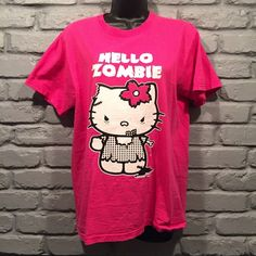 Hello Kitty Zombie t shirt PRICE IS FIRM!(FINAL PRICE DROP! PRICE WILL GO BACK UP THE DAY AFTER VALENTINES DAY!) Adult size medium. Small flaw seen in 3rd picture. Only worn a few times.                                    NO TRADES/ PAYPAL ✔DON'T ASK FOR MY LOWEST PRICE, PLEASE USE OFFER BUTTON ❤️BUNDLE TO SAVE! ⏳I ONLY HOLD ITEMS FOR 24 HOURS Tops Tees - Short Sleeve