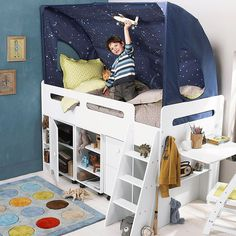 how cute. Love the outer space bed canopy...wonder if the stars glow in the dark?