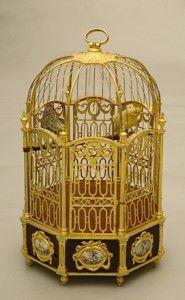 reloj en forma de jaula..........