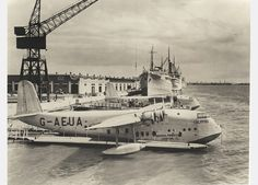 Imperial Airways' Empire flying boat G-AEUA Calypso alongside its sister ship VH-ABD Corio of QANTAS