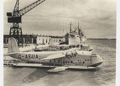 Imperial Airways' Empire flying boat G-AEUA Calypso alongside its sister ship VH-ABD Corio of QANTAS
