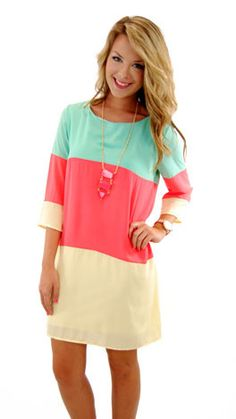 So pretty....coral, mint and yellow 3/4 sleeve tunic dress. The Blue Door Boutique