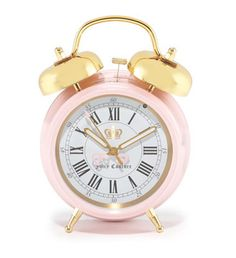 "Rise and shine! This classy, rose alarm clock will cheerfully get you to class on time. (And of course it is a chic addition to your dorm too!) ***Note: I later pinned ""Roommate Rings"" that were a very brilliant invention ... I am torn in choosing the best between these two fabulous options***"