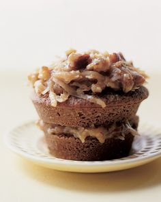 """JUST in case Icing on the top of the cake WASN""""T Enough CALORIES   we'll squeeze in a FEW MORE!... German Chocolate Cupcakes - Martha Stewart Recipes"""