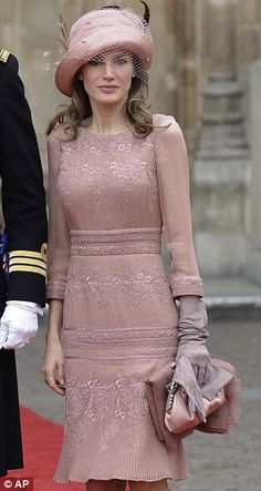 Princess Letizia of Spain wearing a pale pink bandage dress by Felipe Varela with matching shoes and cloche hat.  The Royal Wedding April 2011.