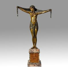 Dancer with Scarf by Demetre Chiparus - An elegant and very rare early 20th Century patinaed and cold painted enamel bronze figure of an attractive dancer in a striking stylised pose holding aloft a scarf, with excellent detail and rich colour. Raised on a marble plinth with frontis plaque and signed.