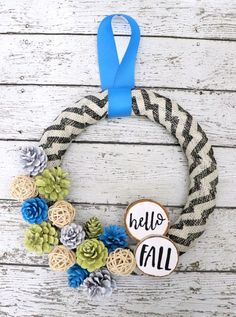 Hello fall pinecone wreath with burlap and chevron. Make this blue and yellow fall wreath with pinecones. #fall #wreath #piencone #burlap #frontporch #DIYhomedecor