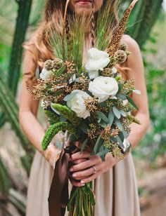 Hand tied bouquet of Juliette, blush tea roses, seeded eucalyptus and varied succulents tied with a natural ribbon wrap. whimsical desert bouquet. The Sparrows Lodge.