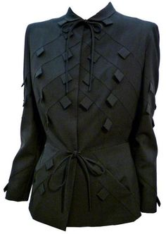 Jacket, Gilbert Adrian, 1940s  Note the use of tabs, sewn in diagonal seams.