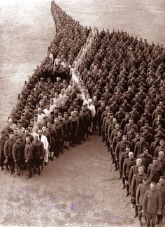 STRANGE MILITARY DISPLAY - 1915 AUXILIARY REMOUNT DEPOT NO 326, CAMP CODY, DEMING NEW MEXICO - 650 OFFICERS AND ENLISTED MEN