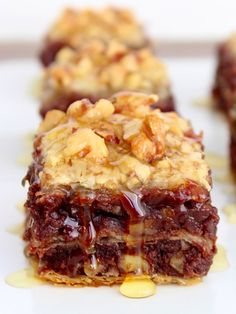 Crunchy layers of phyllo dough filled with fudgy cinnamon-spiked walnut brownie and soaked in sweet honey to become brownie baklava bliss!