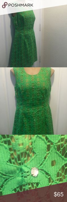 """Vintage 60's Ann's Vogue Shoppe Green Lace Dress Women's Vintage 60's Ann's Vogue Shoppe Green Lace & Rhinestone Dress  Perfect for the holidays Unmarked size but fits like M/L    Approx measurements laying flat  Shoulder strap 4"""" Shoulder to underarm opening 7.5"""" Across chest WHICH IS DARTED 19.5"""" Across waist 16.5"""" Collar to hem edge 32"""" Anne's Vogue Shoppe Dresses Midi"""