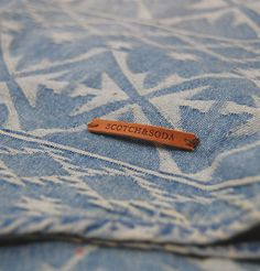 The new Button Down Dress Shirt from Scotch and Soda is a beautifully crafted light denim shirt. The shirt features an Aztec pattern throughout which is incorporated into the denim itself. The shirt has a button closure to the front with the cuff being closed by a two button closure.