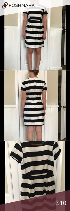 Black and White Striped Dress This dress is so cute and in brand new condition! I love it, it is just too big for me. I would say it runs small for a ten, like most clothes from H&M. I am usually a four and this was probably a size or two too big. It is fitted on top and flows out just a little bit in the bottom. It is made of 98% cotton and 2% elastane. H&M Dresses