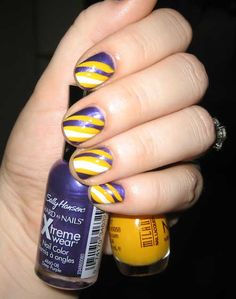 Purple Yellow and White. LOVE THE COLORS!! I LOVE PURPLE ON MY NAILS :))