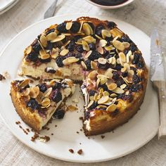 Baked dark cherry and almond cheesecake recipe. A dense, creamy cheesecake that is not too sweet served with a cherry compote on top. A perfect partner with a mid morning cup of coffee. Buy the best almond extract that you can find.