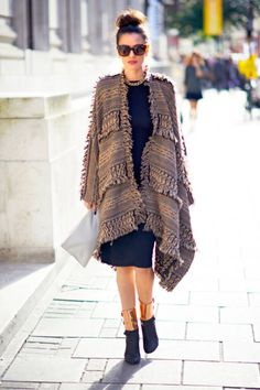 Street Style London Fashion Week SS13:the classic LBD updated with metallic ankle-cuff booties and a comfy wool sweater on Fashion Director Leila Yavari's outfit.