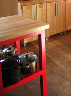 """2 cheap coffee tables = 1 great kitchen island .... """"Apartment Therapy's Kyle Freeman decided to stack two IKEA LACK side tables to create their own kitchen island"""""""