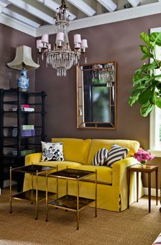 yellow sofa, brown walls double coffee table