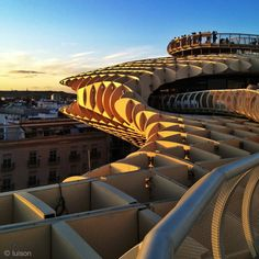 The Metropol Parasol in Sevilla, España, the largest wooden structure in the world!  The view is breathtaking as you can see the entire city from the mushroom like top!