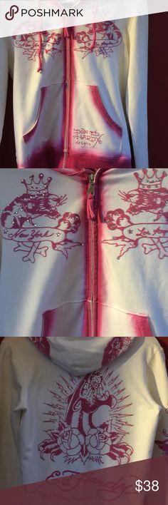 Ed Hardy New York Sweatshirt NWOT White with Pink zip up hoodie w/rhinestones.. Very cool sweatshirt. I Bought but unfortunately was not ever able to fit in it. Ed Hardy Tops Sweatshirts & Hoodies