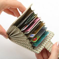 Finally - a credit card holder that fits credit cards, debit cards and store reward cards. And you can get them out of the slots! Great idea...!