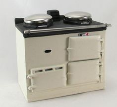 Miniature AGA style range for a 12th scale dolls house kitchen.