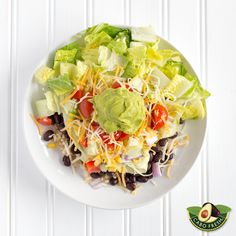 Guacamole Salad Bowl with Brown Rice and Beans Recipe. A supremely healthy and delicious lunch or dinner salad that's easy to make and bursting with flavor. Featuring brown rice, black beans, Greek yogurt, and Cabo Fresh Guacamole (Spicy works well), it's a powerhouse of protein, rich in taste, texture, and packed with vitamins and nutrients.