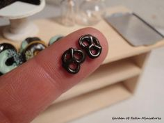 Mini chocolate covered pretzels, polymer clay. Made by Garden of Eatin' Miniatures (Angela D'Onofrio)