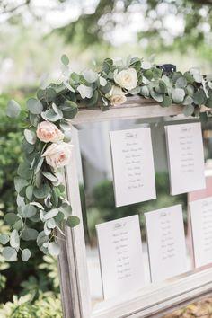 Wedding Seating Chart Florals, greenery, mirror