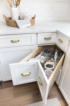 A super smart solution for using the corner space in a kitchen - kitchen corner drawers! #kitchendesign #kitchencabinets #kitchenorganization #kitchen #kitchens #kitchenstorage #kitchenstorageideas #kitchendecor #kitchendesignideas #kitchenremodel #kitchenrenovation