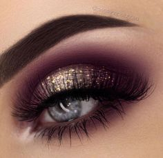 Smokey royal purple with gold glitter eyeshadows.
